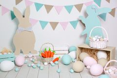 Easter! Many colorful Easter eggs with bunnies and baskets! Easter decoration of the room, children`s room for games. Basket with royalty free stock photo