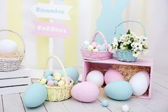 Easter and spring decor. Large multi-colored eggs and Easter bunny. royalty free stock photo