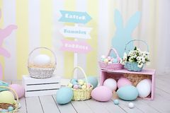 Easter and spring decor. Large multi-colored eggs and Easter bunny. stock images