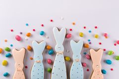 Easter spring decorative composition. Cookies in the shape of funny bunny. And colored sprinkles Stock Images