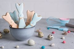 Easter spring decorative composition  with homemade easter cookies in the shape of  a  funny  rabbit, quail eggs and tools necessa. Ry to make gingerbread pastry Royalty Free Stock Photos