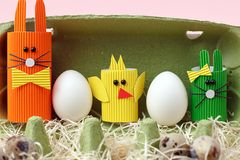 Easter spring decorative composition with homemade easter paper craft funny rabbit, chickens and quail eggs .Holiday celebration. Decorations stock image