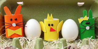 Easter spring decorative composition with homemade easter paper craft funny rabbit, chickens and quail eggs .Holiday celebration. Decorations stock photography