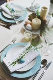 Easter and spring festive table decorated in blue and white tones in natural rustic style, with eggs, bunny, fresh flowers. And candles royalty free stock photos