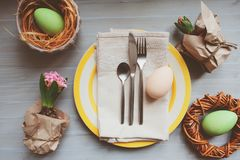 Easter and spring preparations. Festive table setting with Hyacinth and eggs, top view. Selective focus, cozy home interior Stock Photo