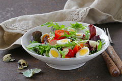 Easter Spring salad with quail eggs, tomatoes Royalty Free Stock Image