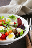 Easter Spring salad with quail eggs, tomatoes Stock Image