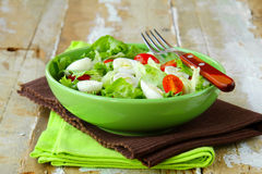 Easter Spring salad with quail eggs, tomatoes Royalty Free Stock Images