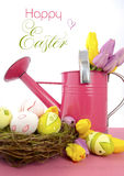 Easter Spring theme pink watering can Stock Photo