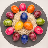 Easter or spring themed background with colored eggs Royalty Free Stock Images