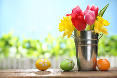 Easter. Spring tulips and easter eggs on table stock images
