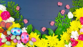 Easter springtime overhead flat lay display of fresh flowers Stock Photo