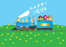 Easter Steam Train. A Steam Train loaded with Easter Eggs driven by a Rabbit wishing Happy Easter in smoke Stock Photos