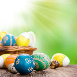 Easter still life. Beautiful hand-painted eggs in basket Stock Photos