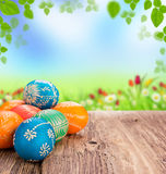 Easter still life. Beautiful hand-painted eggs on wooden plank Royalty Free Stock Images