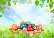 Easter still life. Hand-painted easter eggs in basket Royalty Free Stock Photo