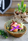 Easter still life with basket and flowers Stock Photo