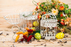 Easter Still Life. Bird Cage With Quail Eggs And Spring Flowers Stock Images