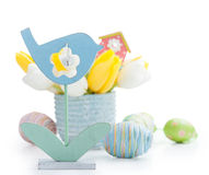 Easter still life with blue bird. Easter decoration with eggs, blue bird and tulip flowers Stock Photography