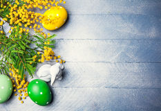 Easter still life with branch mimosa eggs Stock Photo