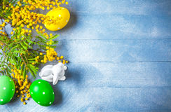 Easter still life with branch mimosa eggs Royalty Free Stock Photos