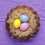 Easter still life, Easter cake, on a violet textile background. stock photography