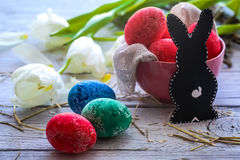 Easter still life with colored eggs and  rabbit Stock Images