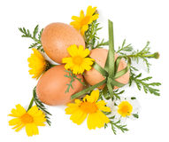 Easter still life of decorative eggs and spring flowers Stock Photo
