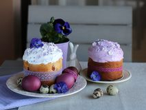 Easter still life, Easter cake, chicken and quail eggs, on a violet and gray textile background. royalty free stock images