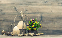 Easter still life  with eggs and pansy flowers. Vintage style Stock Photo