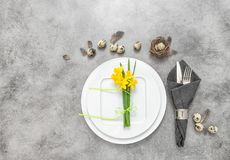 Easter still life place setting decoration eggs flowers Stock Photos