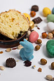 Easter still life with items like rabbit, eggs, confetti, chocol Stock Image