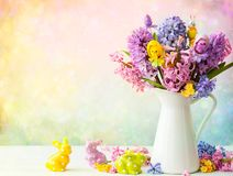 Easter still life with flowers and Easter rabbits. Easter still life with lilac and pink hyacinths, Easter eggs and bunny on white background stock image