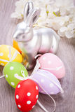 Easter still life with a silver bunny and eggs Royalty Free Stock Photography