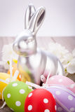 Easter still life with a silver bunny and eggs Royalty Free Stock Image