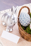 Easter still life with a silver bunny and eggs Royalty Free Stock Photo