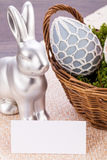 Easter still life with a silver bunny and eggs Stock Image