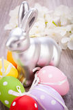 Easter still life with a silver bunny and eggs Stock Photo