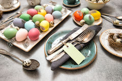 Easter still life table place  decoration colored eggs Stock Photos