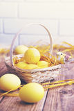 Easter still yellow eggs, tinted Stock Photos