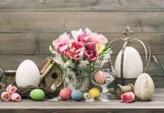 Easter stillife. tulip flowers and colored eggs Royalty Free Stock Image