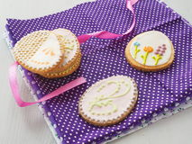 Easter sugar cookies with floral ornament. Homemade cookies decorated in the shape of easter egg. Stock Photo