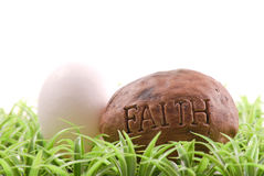 Easter Sunday Religious Beliefs. With Egg And Faith Stone Stock Photos