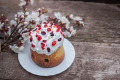 Easter sweet bread Orthodox kulich, paska, willow twigs. Easter Colorful eggs on gray wooden background. Easter Holidays. Breakfast. Easter Palm Sunday. Space Stock Image