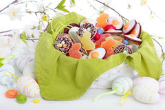 Easter sweets in a basket Stock Image
