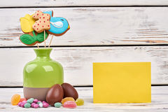 Easter sweets and blank card. Royalty Free Stock Photo