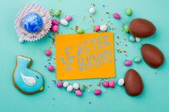 Easter sweets, chocolate and card. Royalty Free Stock Photos