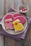 Easter sweets on a rustic table royalty free stock photography