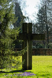 Easter symbol cross sculpture in park Stock Photos