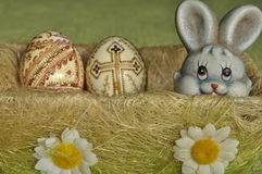 Easter. Symbols of Christmas. Rabbit, chicken and eggs. Willow twig Stock Photos